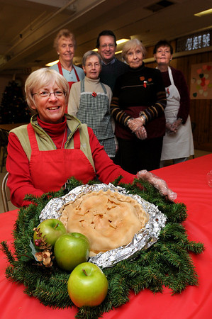 Salisbury:<br /> Jan Juntenen, front, and her helpers at the East Parish United Methodist Church in Salisbury are making pies decorated with miniature angels for holiday gifts as a fundraiser. From left, Juntenen, Madolyn Lynch, Barbara Rogers, Rev. Rusty Davis, Kay Knowles and Carol Holland.<br /> Photo by Bryan Eaton/Newburyport Daily News Thursday, December 11, 2008