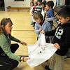 "Newburyport:<br /> Brown School physical education teacher Cathy Hill reacts as children in Dianna Ouellette's kindergarten class present her with decorated pillowcases and letters for her son, Marine Sgt. Michael Hill who is serving his third tour in Iraq and won't be home for Christmas. The ""Pillowcase Project"" has special meaning for Ouellette as her sister-in-law, Sue Hines, mother of slain soldier Derek Hines, sent freshly washed pillow cases to him while serving in Afghanistan.<br /> Photo by Bryan Eaton/Newburyport Daily News Tuesday, December 09, 2008"