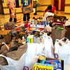 Newbury:<br /> FIfth grade teachers at Newbury Elementary School asked their students that instead of any gift they might want to give them, they instead make a food donation which would go the the Pettengill House food pantry. Student representatives from each class dropped the goods to a central spot Monday for pickup, from left, Cassidy Brown and Tommy Walsh, both 11, Maya White and Luis Fernandez, both 10.<br /> Photo by Bryan Eaton/Newburyport Daily News Monday, December 22, 2008