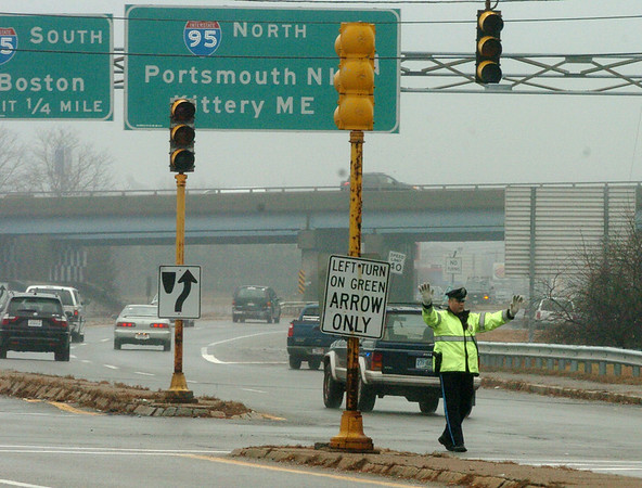 Salisbury:<br /> A Salisbury police officer directs traffic on Route 110 at the Crossroads Plaza near the Amesbury as traffic lights were without power. Photo by Bryan Eaton/Newburyport Daily News Friday, December 12, 2008