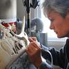 Terri Talas carves a nature scene onto the antler of a caribou in her Newburyport studio.<br /> Photo by Bryan Eaton/Newburyport Daily News  Thursday December 18, 2008