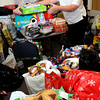 Newburyport:<br /> Salvation Army Major Kathryn Purvis received several presents from an anonymous donor yesterday afternoon adding to the pile of presents in this and another room. Gift donations to the organization, which distributes them to needy children, has been more generous that anticipated despite the economy.<br /> Photo by Bryan Eaton/Newburyport Daily News Thursday, December 18, 2008