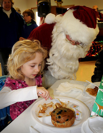 Salisbury:<br /> Santa Claus checks on Taylor Little, 6, of Salisbury as she eats her pancakes at the Hilton Center in Salisbury on Saturday. They were at the Salisbury Firemens Association's annual pancake breakfast.<br /> Photo by Bryan Eaton/Newburyport Daily News Saturday, December 13, 2008