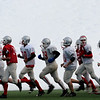 Amesbury:<br /> The Amesbury High football team runs past piles of snow at Amesbury Sports Park training for their game against Whitter Vocational tonight in Lowell. Snowmaking is on hold for now as the temperatures this week will be well above freezing.<br /> Photo by Bryan Eaton/Newburyport Daily News Monday, December 01, 2008