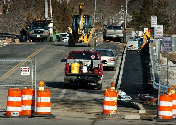 Newbury:<br /> A bulldozer heads over the roadway of the Route 1A bridge in Newbury over the Parker River in view looking north. A construction crew works  on the sidewalk section as the bridge is just about ready to reopen.<br /> Photo by Bryan Eaton/Newburyport Daily News Monday, December 29, 2008