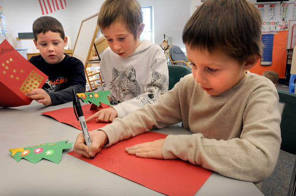 Salisbury:<br /> First and second-graders at Salisbury Elementary School wrote holiday cards for soldiers in Iraq and Afghanistan to be distributed through the American Red Cross. Working on theirs are, from left, Alex Conroy, 6, Eric Souther, 8, and Jared Proulx, 6.<br /> Photo by Bryan Eaton/Newburyport Daily News Wednesday, December 03, 2008