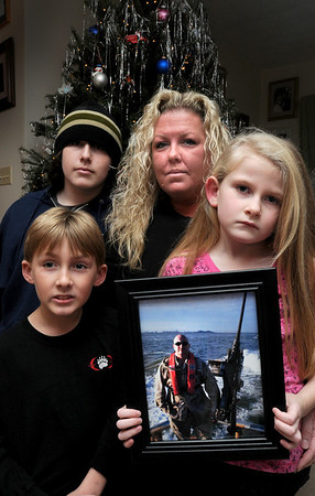 Salisbury:<br /> Michelle Kimball and her children are spending Christmas without their father, Kenneth, a US Coast Guard Chief Petty officer out of Station Merrimack, who was just deployed to Iraq. Clockwise, from left, front, Ethan, 8, Zack, 14, Michelle and Mackenzi, 6.<br /> Photo by Bryan Eaton/Newburyport Daily News Tuesday, December 16, 2008