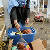 Amesbury:<br /> Rosemary Werner of Our Neighbor's Table looks through the last of turkeys and other food that is being thrown out as a generators purrs in the ground. The organization had to throw out food as the ice storm cut electricity to freezers containing the holiday day goods.<br /> Photo by Bryan Eaton/Newburyport Daily News Tuesday, December 16, 2008