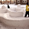 Newburyport:<br /> Isaac Butler, 6, left, and Mackenzie Ellison, 8, play in a snow maze at Park Circle in Newburyport on Monday after school. The maze was built by resident David Nicholson for the children as no Christmas lighting is allowed at the complex over fire saftey concerns.<br /> Photo by Bryan Eaton/Newburyport Daily News Monday, December 22, 2008