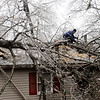 Amesbury:<br /> Larry Benjamin removes branches from the huge limb that landed, and broke into the roof, on his 19 First Street home in Amesbury.<br /> Photo by Bryan Eaton/Newburyport Daily News Friday, December 12, 2008