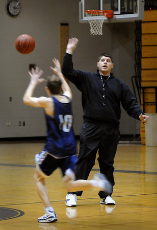 Newbury:<br /> New Triton head basketball coach Ryan Souliotis works with his team.<br /> Photo by Bryan Eaton/Newburyport Daily News Tuesday, December 09, 2008