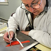 Amesbury:<br /> Ann Cote studies the picture of a male cardinal as she paints a copy Wednesday morning. She was in the watercoloring class at the Amesbury Senior Center<br /> Photo by Bryan Eaton/Newburyport Daily News Wednesday, December 10, 2008