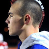 LOWELL: Dedicated Amesbury Indian fan, Perry Mroz, 13 show his support by wearing a red and white mohawk as he watches the game on the sidelines. The Indians defeated Whittier Tech. (Haverhill) in football playoff action 34-0.   <br /> <br /> Photo by Carl Russo/Newburyport Daily News Tuesday, December 02, 2008