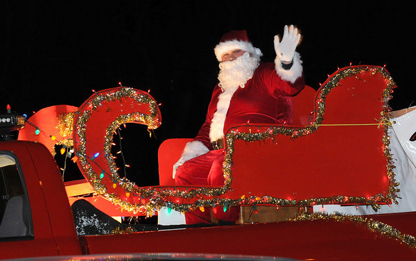 Salisbury:<br /> Santa Claus heads out on Route One from the Salisbury Fire Station on Friday night for the annual Santa's Tour Parade. The event is sponsored by the Salisbury Firemen's Association which also sponsors a pancake breakfast next Saturday.<br /> Photo by Bryan Eaton/Newburyport Daily News Friday, December 05, 2008