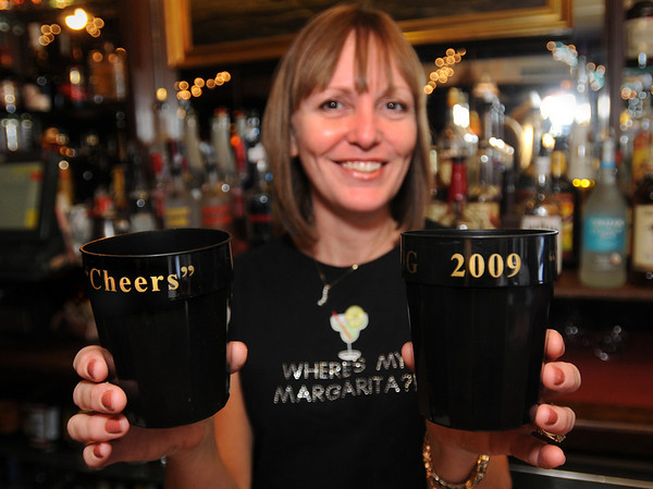 Newburyport:<br /> The Grog restaurant in Newburyport has been handing out commemorative cups to customers on New Year's Eve as bartender Lesley Fitzgerald did yesterday afternoon.<br /> Photo by Bryan Eaton/Newburyport Daily News Wednesday, December 31, 2008