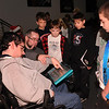 Amesbury:<br /> Aide Kevin Perry holds Jarrod Limbert's arm as they demonstrate to Amesbury Middle School sixth-graders how Limbert uses a Dynavox,  an icon-driven speech device. Interns and clients from the Stepping Stones Group,  a post-rehabilitation program, is part of Krempels Brain Injury Foundation in Portsmouth were at the school to educate the students on brain safety and steps everyone can take to create a safer world.<br /> Photo by Bryan Eaton/Newburyport Daily News Wednesday, December 03, 2008