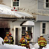 Newbury:<br /> Firefighters quickly put out a fire in an attached garage at 126 Elm Street in Byfield yesterday afternoon. The fire was started by still-hot embers set out taken from a fireplace.<br /> Photo by Bryan Eaton/Newburyport Daily News Tuesday, December 23, 2008
