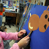 "Newburyport:<br /> Lily Salka, 6, attaches legs to a reindeer in Pam Jamison's art class at the Bresnahan School in Newburyport. The children read the book ""The Wild Christmas Reindeer"" and they were making their own illustrations to go with the reading.<br /> Photo by Bryan Eaton/Newburyport Daily News Monday, December 08, 2008"