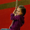 Newburyport:<br /> Madison Schmidt, 6, swings on the climbing rope in Sue Coffey's gym class at the Bresnahan School in Newburyport on Monday afternoon. The children were taking turns on the rope and climbing the rock wall.<br /> Photo by Bryan Eaton/Newburyport Daily News Monday, December 08, 2008