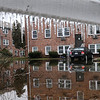 Amesbury:<br /> A women gets into her car in the flooded parking lot at Carriage Hill Estates across from Amesbury Town Park. Lower units in the complex were flooded out in the Mother's Day Storm several years ago.<br /> Photo by Bryan Eaton/Newburyport Daily News Friday, December 12, 2008