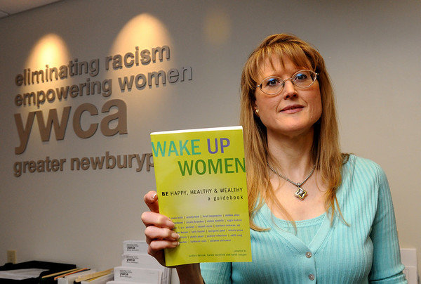 "Newburyport:<br /> Alice Green, coauthor of ""Wake Up Women"" is donating profits from the book to the Newburyport YWCA and the Jeanne Gieger Crisis Center.<br /> Photo by Bryan Eaton/Newburyport Daily News Thursday, December 11, 2008"