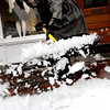 Newburyport:<br /> Yesterday's storm which started as snow, turned to rain and sleet, making walking and driving difficult. Ann Marie Tisevich of Azure on State Street in Newburyport cleaned chunky ice off the sidewalk in front of her store.<br /> Photo by Bryan Eaton/Newburyport Daily News Wednesday, December 17, 2008