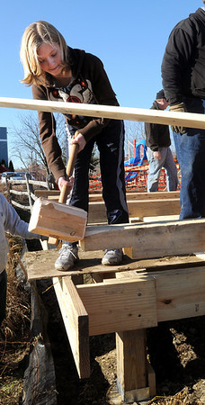 Newburyport:<br /> Olivia Carmichael, 13, pounds a post into place at River Valley Charter School on Wednesday morning. Students and teachers were building a post and beam pavillion uses of which will include the setting for an outdoor classroom.<br /> Photo by Bryan Eaton/Newburyport Daily News Wednesday, December 03, 2008