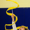 "Amesbury:<br /> Jake Hamel, 8, twirls a dance banner at Amesbury Elementary School to the music from ""The Polar Express"" on Thursday morning. All of December, second-graders in Margaret Welch's physical education classes have been learning different types of dance.<br /> Photo by Bryan Eaton/Newburyport Daily News Thursday, December 18, 2008"