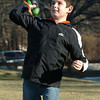 Amesbury:<br /> Paddy Flahardy, 10, of Amesbury throws a football with his father, Kelly, at Amesbury Sports Park on Monday afternoon. Meanwhile, his brothers, Kyle and Trevor, were playing on the playground equipment in the decent weather.<br /> Photo by Bryan Eaton/Newburyport Daily News Monday, December 29, 2008