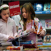 Newbury:<br /> Sheila Cramorn, left, and Christina Duni, both 8, check out the offerings at the Book Fair at Newbury Elementary School on Tuesday which runs all week and raises money for the library.<br /> Photo by Bryan Eaton/Newburyport Daily News Tuesday, December 02, 2008