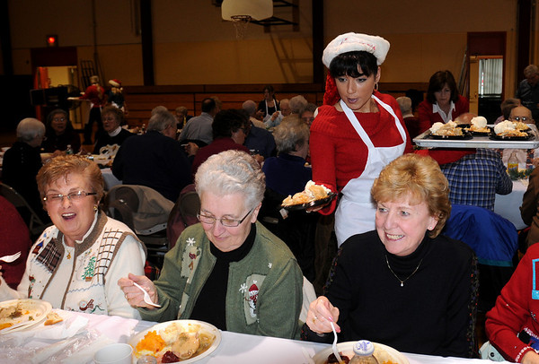 Seabrook:<br /> Melissa Altavilla-Traver serves ice cream and apple pie to, from left, Gerry DeFrancesco, Joanne Jacques and Claire Emery at the Seabrook Recreation Center in Seabrook on Tuesday. They were only three of 250 people who turned out the for the Seabook Police Association's Senior Citizen Holiday Luncheon.<br /> Photo by Bryan Eaton/Newburyport Daily News Tuesday, December 16, 2008