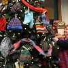 Newburyport:<br /> Betsy Martin of A Loom With a View in Newburyport puts a hat on a Christmas tree in her shop. A Wednesday night knitting club that meets at the store has been making hats, scarves and gloves, and putting them on the Christmas Tree. Next Wednesday, they will deliver them to St. Anne's Home in Methuen, a residential treatment center for adolescents.<br /> Photo by Bryan Eaton/Newburyport Daily News Thursday, December 11, 2008