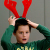 "Salisbury:<br /> Ryan Farrell, 9, adjusts his reindeer antlers which kept falling off yesterday morning at Salisbury Elementary School. He was in gym class playing an indoor ""snowball"" game which is similar to dodgeball and uses small foam balls.<br /> Photo by Bryan Eaton/Newburyport Daily News Tuesday, December 23, 2008"