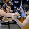 Newbury:<br /> Whittier's Pat Scheidegger, left, wrestles Triton's Adam Ouellet in the 215 lb. weight class.<br /> Photo by Bryan Eaton/Newburyport Daily News Wednesday, December 31, 2008