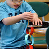 Salisbury:<br /> Arthur Stanley, 4, uses all his might to squeeze a stapler as he creates a Christmas chain in Maureen Doyle-Winn's preschool class at Salisbury Elementary School on Wednesday. The children will take the chains home a remove a link each night until Christmas.<br /> Photo by Bryan Eaton/Newburyport Daily News Wednesday, December 03, 2008
