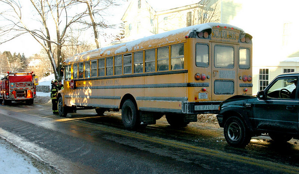 Newbury:<br /> An occupied school bus was involved in a minor accident on Rolfe's Lane, just north of High Road, in Newbury early yesterday morning.<br /> Photo by Bryan Eaton/Newburyport Daily News Tuesday, December 23, 2008