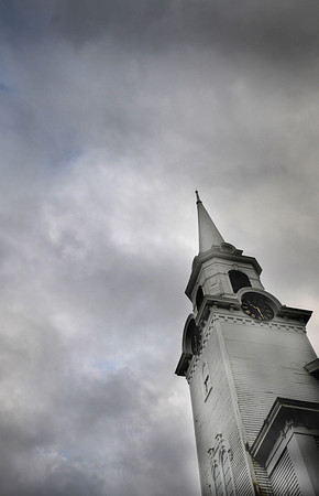 Newbury: Clouds move across the sky behind the steeple at the First Parish Church in Newbury. by Jim Vaiknoras.Newburyport Daily News. Saturday December 27, 2008