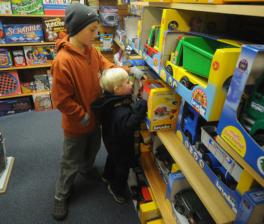 Newburyport: Noah Kolesha, 10 and his brother Logan, 3, shop for bargins at the Dragon's Nest in Market Square in Newburyport Friday morning. photo by Jim Vaiknoras/Newburyport Daily News. Friday December 26, 2008