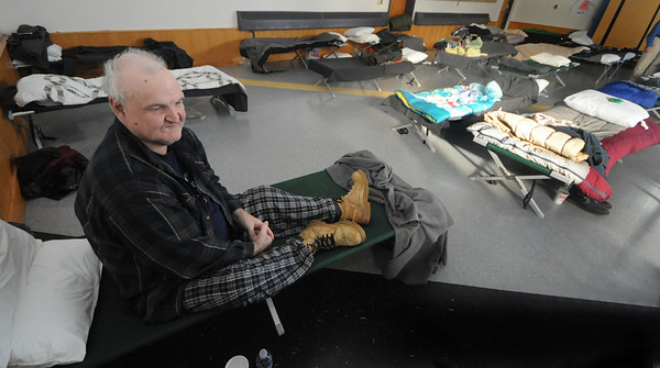 Amesbury:Robert Janvrin rests on one of the cots set up in a shelter at Amesbury Middle School for people who had to leave their homes due to power outages caused by Friday ice storm. photo by Jim Vaiknoras/ Newburyport Daily News. Sunday December 14, 2008