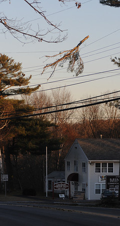 Amesbury: A branch hangs from wires over Rt 110 in Amesbury Saturday.<br /> photo by Jim Vaiknoras/Newburyport Daily News. Saturday December 13, 2008