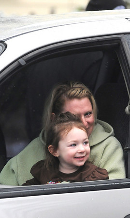 Merrimac:Isabell Lischke, 2, and her mom Lynn keep warm in their car at the annual Merrimac Santa Parade.photo by Jim Vaiknoras/Newburyport Daily News. Sunday December 7, 2008