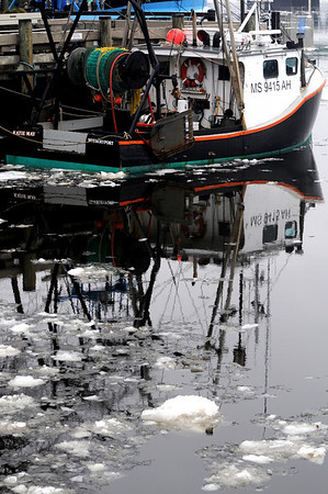 "Newburyport: The fishing boat ""Katie May"" is reflected in the water and melting ice along Market Landing Park in Newburyport.photo by Jim Vaiknoras.Newburyport Daily News. Saturday December 27, 2008"