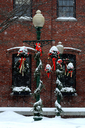 "Amesbury:"" It's Christmas Time in the City"". Christmas decorations on street lamps get covered with snow Sunday .photo by Jim Vaiknoras/Newburyport Daily News.Sunday December 21, 2008"