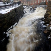Amesbury: The Powow River swollen by melting snow rushes it's way through the Mill Yard in Amesbury Sunday morning. photo by Jim Vaiknoras.Newburyport Daily News. Saturday December 27, 2008