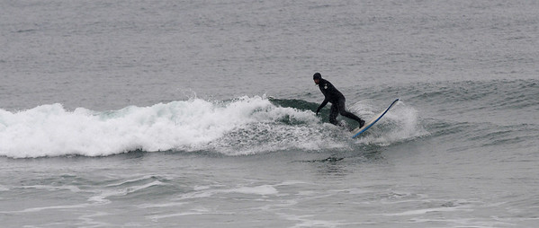 Salisbury: A surfer braves the waves and the snow off Salisbury Beach Sunday morning. photo by Jim Vaiknoras/Newburyport Daily News. Sunday December 7, 2008