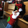 Newburyport: Lila Leonard, 7, takes a break while working at the Polar Express at the Newburyport MBTA station. The event raised money for the Imaculate Conception School. photo by Jim Vaiknoras/Newburyport Daily News . Saturday December 6, 2008