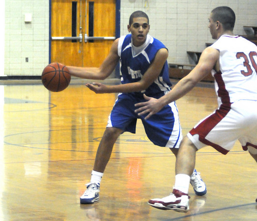 Winthrop:Georgetown's Tyran Harrigan looks to pass during their basketball  game against Amesbury Saturday at Winthrop High in the annual Christmas Tournament.photo by Jim Vaiknoras.Newburyport Daily News. Saturday December 27, 2008