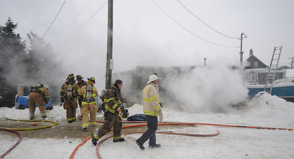Salisbury: Firefighters battle smoke, cold and snow at a fire Saturday afternoon on Brissette Avenue in Salisbury. photo by Jim Vaiknoras/Newburyport Daily News. Saturday December 20, 2008
