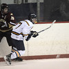 Peabody:Newburyport's Kevin Holmes knocks the puck away from Lynnfield's Gaven LaValley Saturday in Peabody.photo by Jim Vaiknoras.Newburyport Daily News. Saturday December 27, 2008