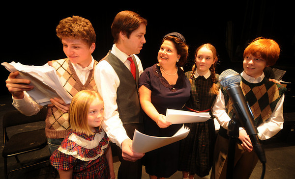 """Byfield: Matt Kiely as Pete Bailey, Annie Moore as Zuzu,Scott Smith as George Bailey , Bonniejean Wilbur as Mary Baily, Madeleine Moore as Janie and Myles Badger as Tommy  in a rehearsal for Theater in the Open's """"It's a Wonderful Life: A Live Radio Show""""The the Governor's Academy Saturday<br />  Photo by Jim Vaiknoras/Newburyport Daily News. Saturday December 13, 2008"""